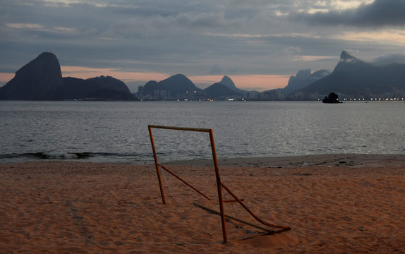 A goalpost is pictured on Icarai beach in Niteroi with Rio de Janeiro's skyline in the background