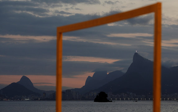 A goalpost is pictured on Icarai beach in Niteroi with the statue of Christ the Redeemer and Rio de Janeiro's skyline in background