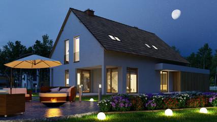 Einfamilienhaus mit Licht im Garten nachts Fototapete