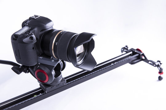 camera on a video slider on a white background. isolated