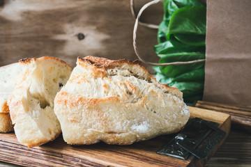 Green salad and freshly cut bread