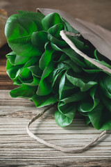 Green salad on rustic wooden table