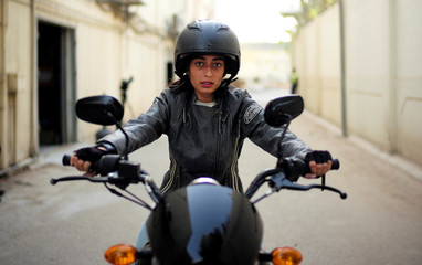 Hanan Iskandar rides a bike during her advance bike-riding training at Harley Davidson dealer in Al Khobar