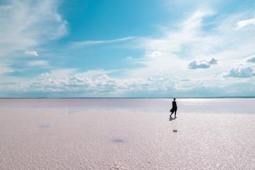 Silhouette women walking on the famous tourist destination Salt Lake (Turkish: Tuz Golu ) is the second largest lake in Turkey.