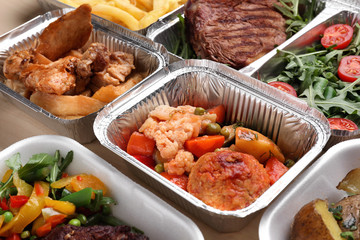 Different containers with delicious food, closeup. Delivery service