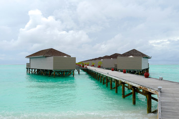 Summer concept , Beach villa on turquoise sea color at maldives on the weekend holidays