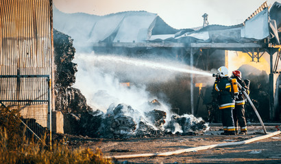 Firefighters extinguish landfill fire