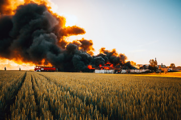 Firefighters battle with huge fire among fields