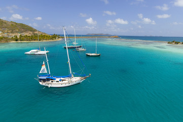 anchoring sailbooats in the shallow waters of Union Island,St.Vincent and Grenadines,West Indies