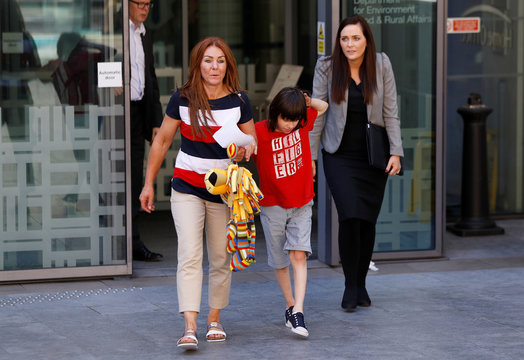 Charlotte Caldwell, and her son Billy, walk out of the Home Office with MP Orfhlaith Begley, during a break in a meeting with officials to discuss how Billy can have his severe epilepsy treated with cannabis oil, which is a banned substance in Britain, in