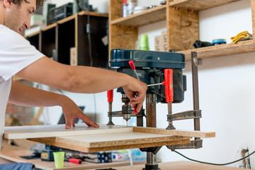 Carpenter drilling holes