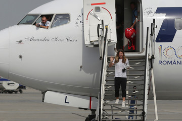 Simona Halep of Romania waves as she descends from the airplane that brought her home following her win at the 2018 French Open at Roland, in Otopeni