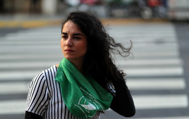 A woman who had an abortion a few years ago gestures during an interview with Reuters in Buenos Aires