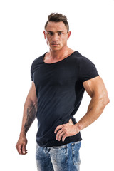 Handsome athletic muscle man in black t-shirt isolated on white, looking at camera