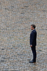 """French President Emmanuel Macron attends the """"prise d'armes"""" military ceremony at the Invalides in Paris"""