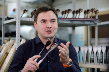 """Designer Nugmanov plays spoons branded """"Spoons of Victory"""", official instrument chosen by Russia for the 2018 FIFA World Cup, at a workshop in Lyubertsy"""