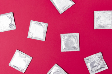 Condoms on pink background. concept of contraception and safe sex. Protection from HIV during sexual intercourse.
