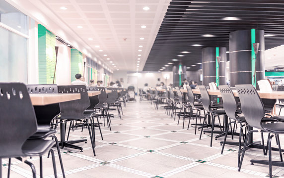 Modern interior of cafeteria or canteen with chairs and tables