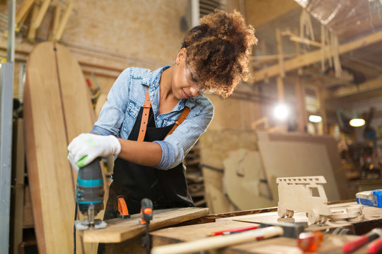 Afro american woman craftswoman working in her workshop