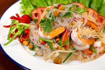 Fresh shrimp spicy salad with vermicelli, thai food delicious in white dish