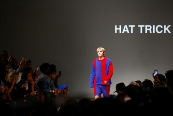 Models present creations at the What We Wear show at London Fashion Week Men's, in London