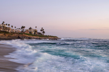 Waves with picturesque cliffs of La Jolla Cove in San Diego California