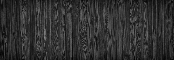 black wooden planks, a panorama of the wood texture with natural patterns