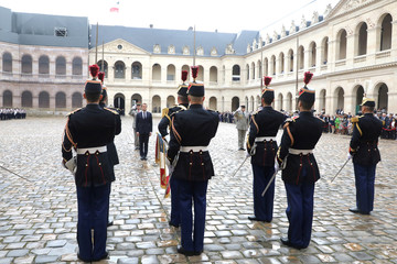 "French President Emmanuel Macron attends the ""prise d'armes"" military ceremony at the Invalides in Paris"