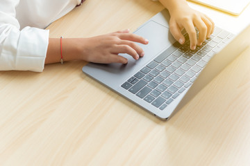 Closeup of business woman hand typing on laptop keyboard, Woman hands typing on laptop.