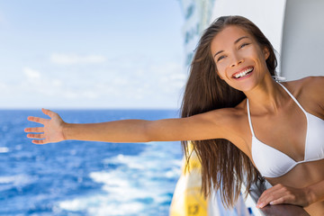 Wall Mural - Cruise ship vacation travel fun freedom woman relaxing with open arms on sea background . Asian tourist girl on holidays feeling free on Caribbean getaway holiday.