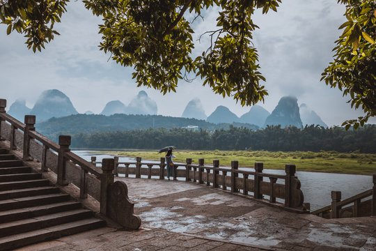 Scenic landscape at Yangshuo County of Guilin. Li River (Lijiang River). Pleasure boats at the pier in Yangshuo Town, China.