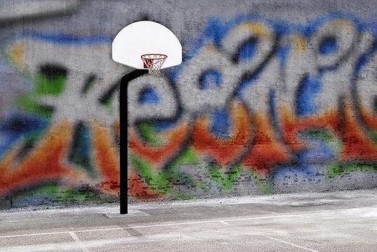 Urban basketball hoop inner city innercity wall and asphalt in outdoor park