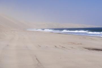 Dunes on the Skeleton Coast / Sandstorm on the Skeleton Coast, dunes to the Atlantic Ocean, Namib Desert, Namibia, Africa.