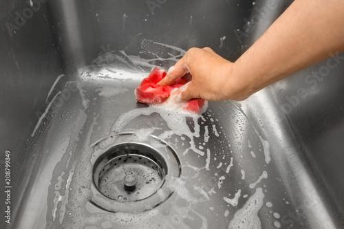 hand cleaning kitchen sink\