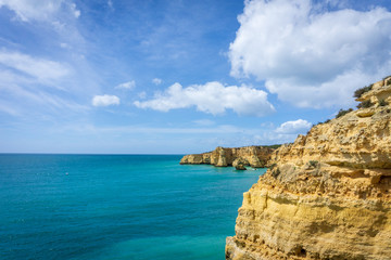 View of beautiful Marinha beach with crystal clear turquoise water near Carvoeiro town, Algarve region, Portugal