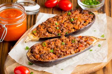 Stuffed eggplant, aubergine, ground beef, pork, vegetables, tomato sauce, rustic style