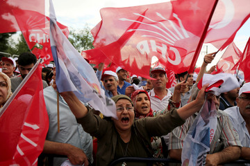 Supporters of Muharrem Ince, presidential candidate of the main opposition CHP, wave Turkish and party flags during an election rally in Diyarbakir