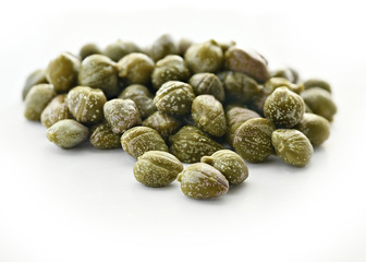 capers, on a isolated white background, selective focus