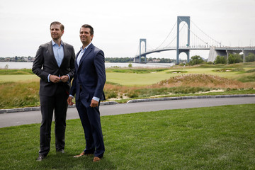 Eric Trump and Donald Trump Jr pose together following the opening ceremony for the clubhouse at Trump Golf Links at Ferry Point in New York