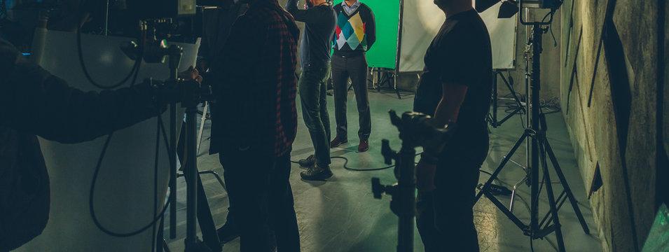 actor in studio posing on green screen