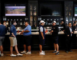Guests are seen inside the clubhouse following the opening ceremony at Trump Golf Links at Ferry Point in New York