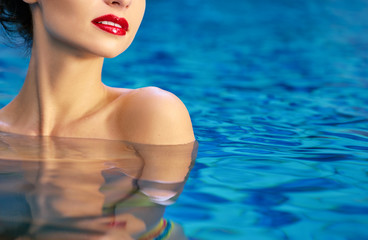 Beauty and skin care. Portrait of sensual young woman red lips make-up in swimming pool.