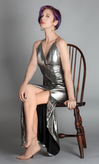 Woman in Metallic Silver Gown Seated in Chair