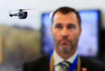 The Black Hornet Nano unmanned aerial vehicle flies during the Eurosatory International Defence Exhibition in Villepinte, north of Paris
