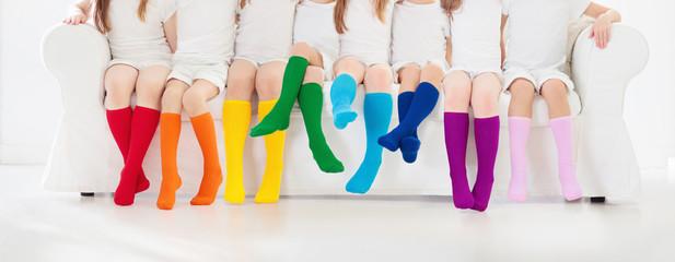 Kids with colorful socks. Children footwear.