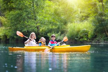 Child on kayak. Kids on canoe. Summer camping.