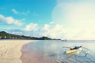 Beautiful landscape. White sand beach with colorful flags on it. Siargao Island, Philippines.