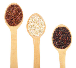 Black red white quinoa seeds in wooden spoon isolated on white background. Top view