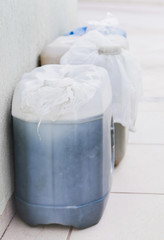 Household storage of gasoline in gallons for a possible lack of fuel. Plastic bag in the lid to not leak or evaporate gasoline.