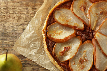Delicious pear tart on table